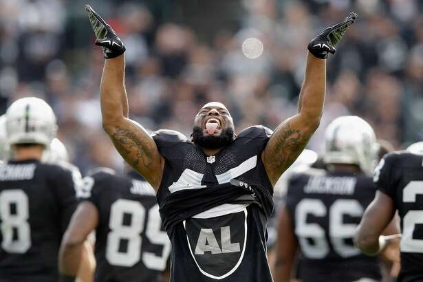 Marcel Reece #45 of the Oakland Raiders runs onto the field for their game against the Buffalo Bills at O.co Coliseum on December 21, 2014 in Oakland, California.  (Photo by Ezra Shaw/Getty Images)