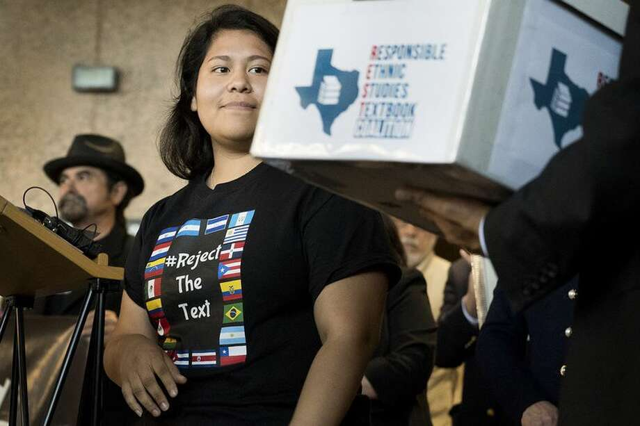 Carolina Hernandez, a student in the Houston ISD, spoke during a news conference at the Texas Education Agency on Nov. 15, 2016, about a proposed Mexican-American studies textbook that educators and activists have criticized. As Hernandez spoke, she glanced at a box holding 15,000 petitions against the textbook.  Photo: Laura Skelding For The Texas Tribune
