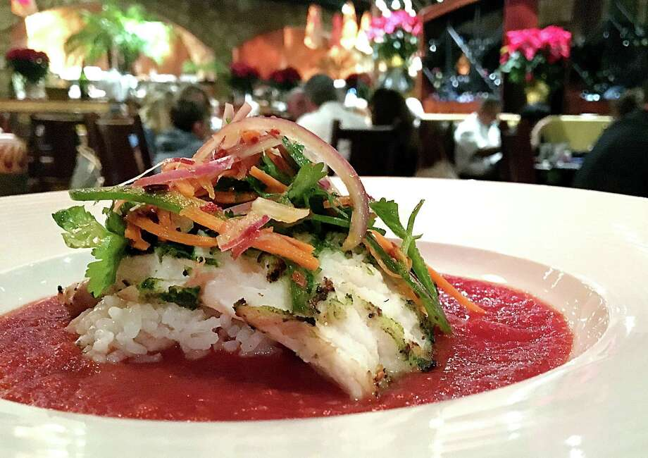 Grilled snapper with Thai salad and tomato-ginger sauce over sushi rice from The Grill at Leon Springs. Photo: Mike Sutter /San Antonio Express-News