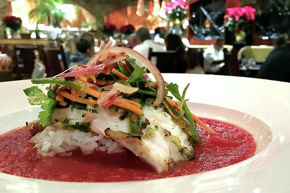 Grilled snapper with Thai salad and tomato-ginger sauce over sushi rice from The Grill at Leon Springs.