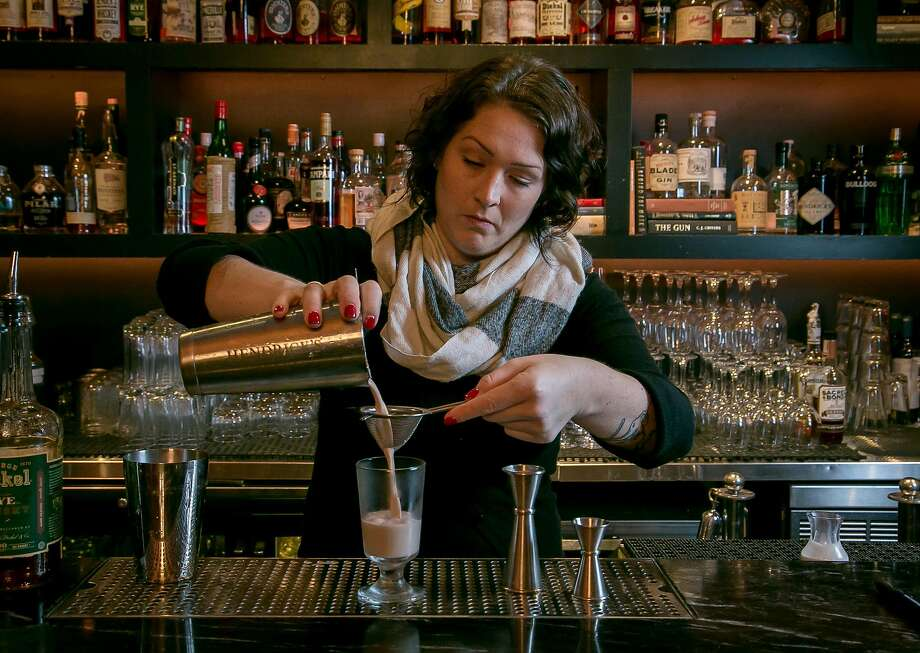 Novela beverage director Suzanne Miller makes an eggnog cocktail at the S.F. bar. Photo: John Storey, Special To The Chronicle