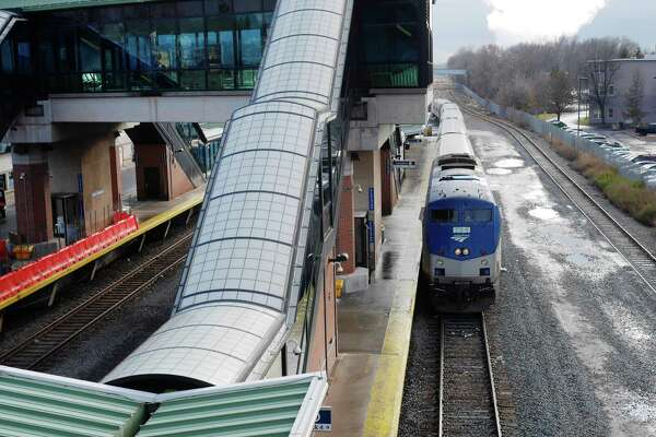 An Amtrak train pulls  into the Rensselaer Train Station on Monday, Dec. 5, 2016, in Troy, N.Y.  For the first time since it opened more than a decade ago, the Rensselaer train station has all four tracks in place, a move intended to eliminate delays.    (Paul Buckowski / Times Union)