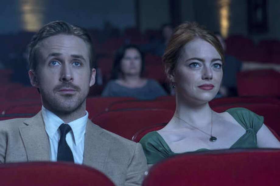 """This image released by Lionsgate shows Ryan Gosling, left, and Emma Stone in a scene from, """"La La Land."""" Damien Chazelle's Los Angeles musical """"La La Land"""" has been named best film of the year by the New York Film Critics Circle. The group announced their picks Thursday, Dec. 1, 2016, on Twitter. (Dale Robinette/Lionsgate via AP) Photo: Dale Robinette"""