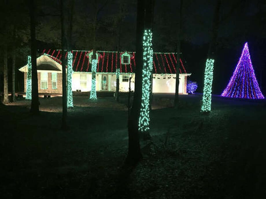 This Nov. 22, 2016, photo shows the light display of the Weeks family on Swartz Fairbanks Road, in Monroe, La. The Weeks are the grand prize winners of the Hallmark Channel Light Up the Holidays Sweepstakes, The News-Star reports. More than 320 man-hours, 25,000 LED lights and 4 miles of copper wire went into the display. (Bonnie Bolden/The News-Star via AP) Photo: Bonnie Bolden