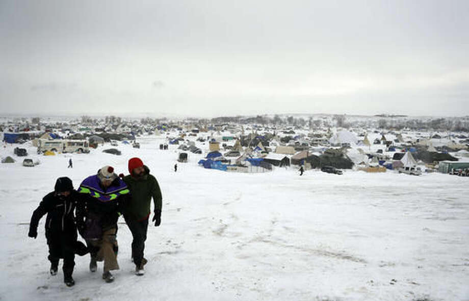 In this Tuesday, Nov. 29, 2016 photo, the Oceti Sakowin camp where people have gathered to protest the Dakota Access pipeline is seen near Cannon Ball, N.D. North Dakota leaders have approved an emergency request to borrow an additional $7 million to cover the cost of law enforcement related to the ongoing protest of the four-state Dakota Access oil pipeline. The state's Emergency Commission voted Wednesday, Nov. 30, to borrow the funds from the state-owned Bank of North Dakota. (AP Photo/David Goldman) Photo: David Goldman