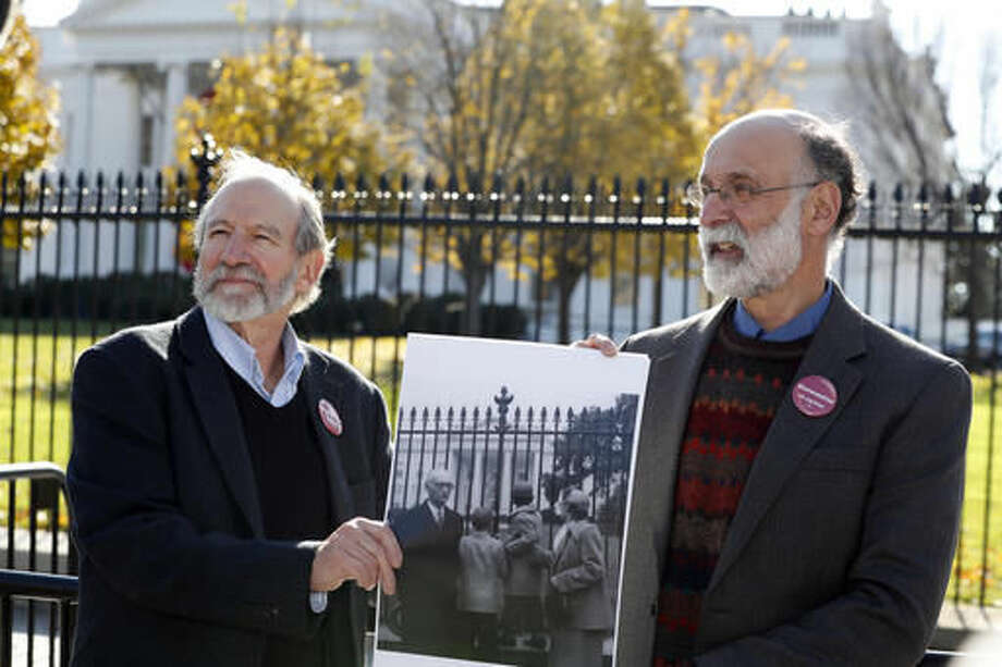CORRECTS THAT THEY ARE SEEKING AN EXONERATION NOT A PARDON - Michael, left, and Robert Meeropol, the sons of Ethel Rosenberg, pose similar to an old photograph of them, before they attempt to deliver a letter to President Barack Obama in an effort to obtain a exoneration for their mother Ethel Rosenberg, in front of the White House, Thursday, Dec. 1, 2016 in Washington. Ethel Rosenberg was executed, along with her husband, Julius, in 1953 after being convicted in a Cold War atomic spying case that captivated the country. (AP Photo/Alex Brandon) Photo: Alex Brandon