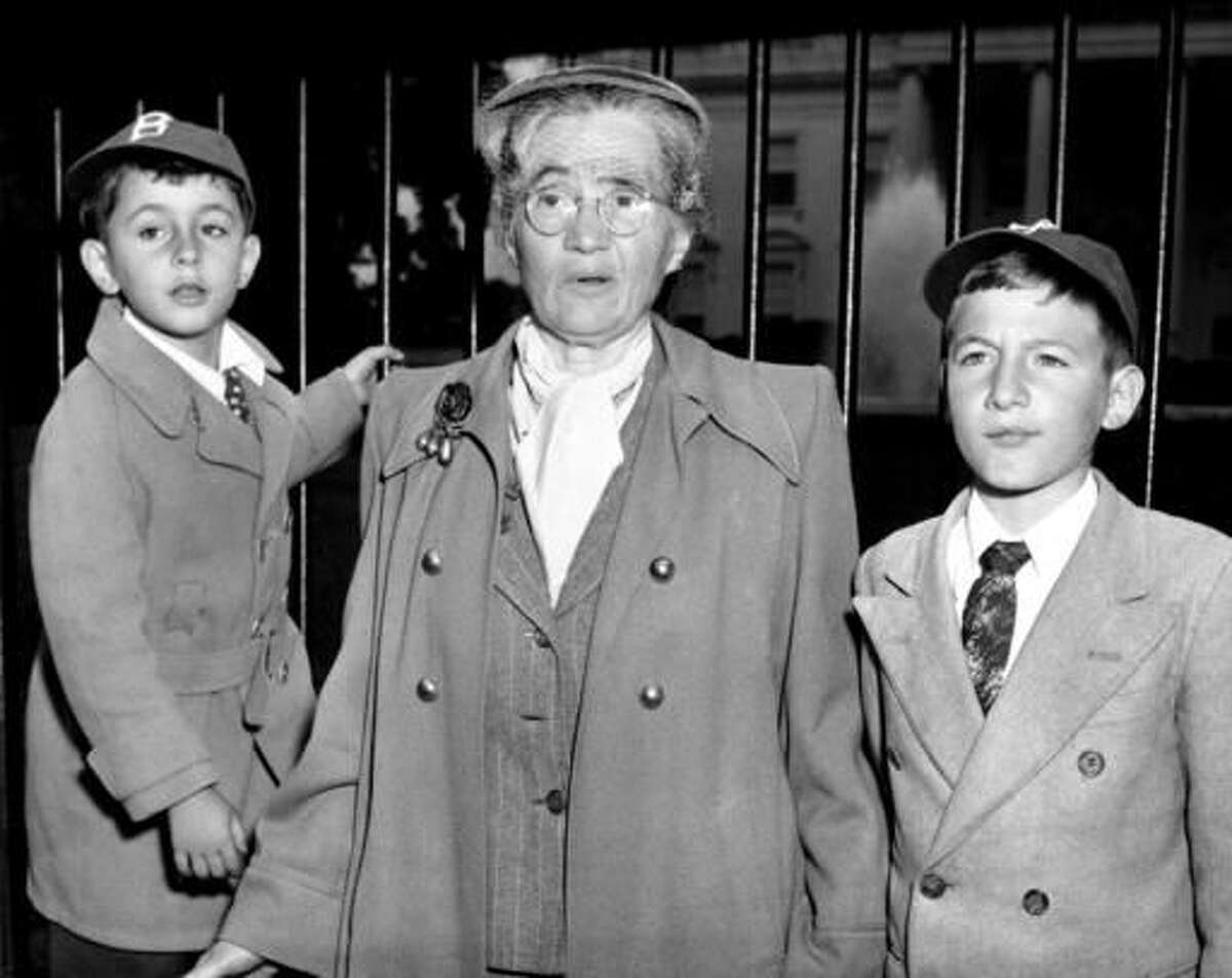 FILE - In this June 14, 1953 file photo, Sophie Rosenberg is shown with her grandsons Robert, 6, left, and Michael, 10, outside the White House in Washington, D.C., during a demonstration seeking clemency for her son Julius and daughter-in-law Ethel Rosenberg. The sons of convicted spy Ethel Rosenberg are asking President Barack Obama to exonerate their mother. Rosenberg was executed, along with her husband, Julius, in 1953 after being convicted in a Cold War atomic spying case that captivated the country (AP Photo)