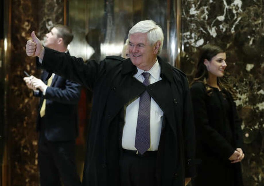 Former House Speaker Newt Gingrich gives the thumps-up as he arrives at Trump Tower, Monday, Nov. 21, 2016 in New York, to meet with President-elect Donald Trump. (AP Photo/Carolyn Kaster) Photo: Carolyn Kaster