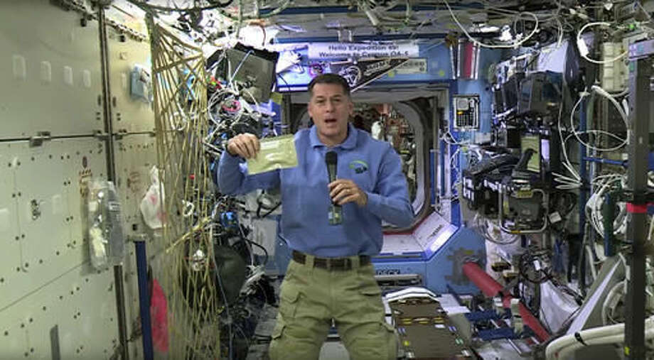 In this image taken from NASA video recorded on Friday, Nov. 18, 2016, NASA astronaut Shane Kimbrough shows a pouch of turkey he will be preparing for his crew in celebration of the Thanksgiving holiday, aboard the International Space Station. (NASA via AP) Photo: HOGP