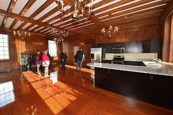 People take a tour as Albany Lofts at One Broadway has an open house on Monday, Dec. 5, 2016 in Menands, N.Y. The building is the former Albany International corporate headquarters. (Lori Van Buren / Times Union)