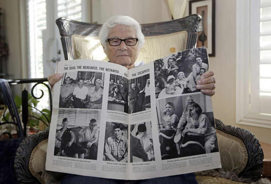 In this Tuesday, Nov. 22, 2016 photo, Frances R. Fuller displays a Life Magazine, from Oct. 31, 1960, with the photo, top left, of her parents William Fuller, left, Jennie Fuller, right, and her brother Robert Fuller, center, at her home in Miami. In 1960, Robert Fuller joined an ill-fated mission to lead a boatload of poorly trained Cubans from Miami in hopes of mustering up a counter-revolution on the island. Instead, the men were quickly captured, and Fuller confessed under torture to counterrevolutionary activities. Fuller was sentenced to death by firing squad. The family asked to bring his body back with them to America. Castro's people said no. (AP Photo/Alan Diaz) Photo: Alan Diaz