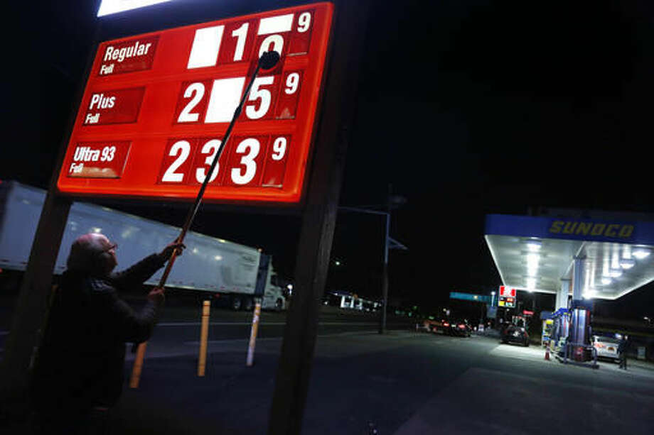 FILE - In this Tuesday, Nov. 1, 2016, file photo, Leon Balagula changes the price for the gasoline at his Sunoco station in the early morning, in Fort Lee, N.J. OPEC's decision on Wednesday, Nov. 30, 2016, to cut production gave an immediate boost to oil prices, but the impact on consumers is likely to be more modest and gradual. (AP Photo/Seth Wenig, File) Photo: Seth Wenig