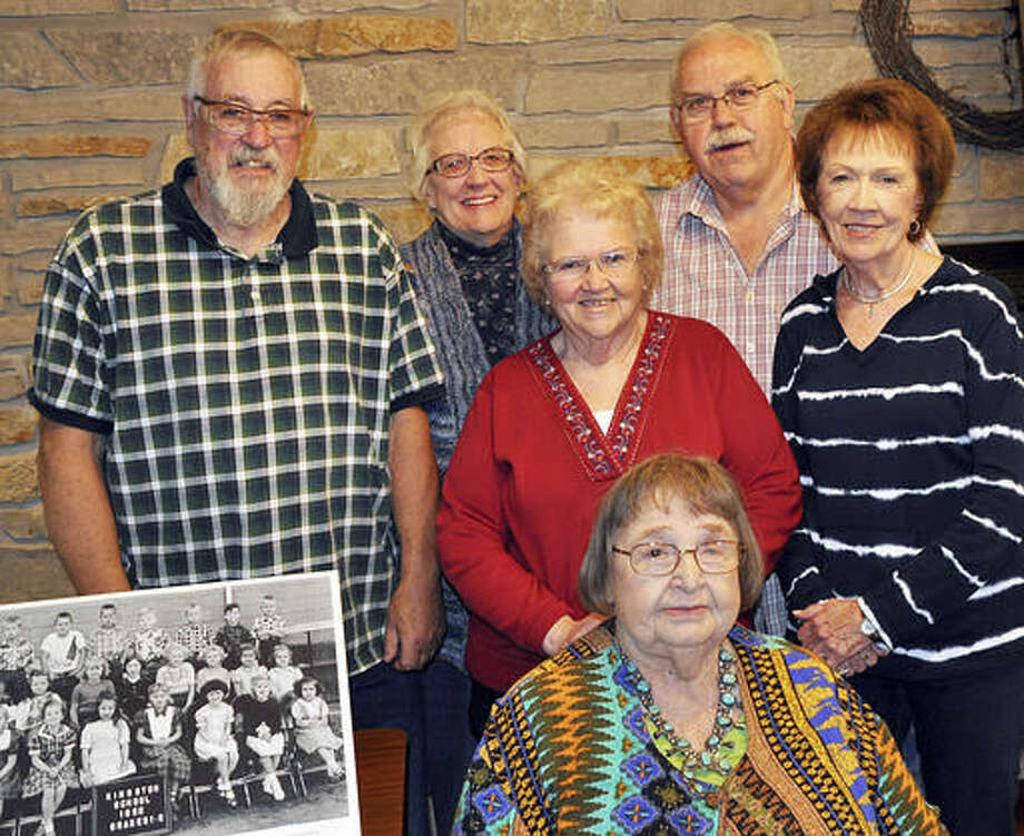 In this Nov. 7, 2016 photo, Alice Paulson, seated, the last surviving teacher who remembers the 1954 Kingston Grade School fire poses with former Kingston Grade School students in DeKalb, Ill. Paulson, spoke about the March 8, 1954 incident at the Oak Crest DeKalb Area Retirement Center, with five former students, all in their 70s, present. She described the phone call early that morning from Genoa-Kingston schools Superintendent Clarence Louderback, explaining there would be no school that day. (Barry Schrader/Daily Chronicle via AP) Photo: Barry Schrader