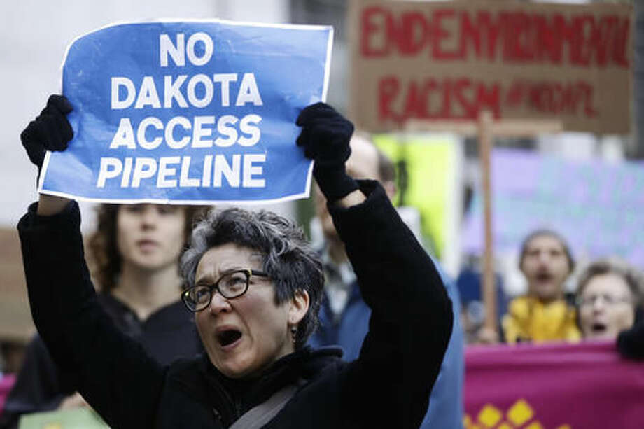 Protesters demonstrate in solidarity with members of the Standing Rock Sioux tribe in North Dakota over the construction of the Dakota Access oil pipeline in Philadelphia, Thursday, Dec. 1, 2016. (AP Photo/Matt Rourke) Photo: Matt Rourke