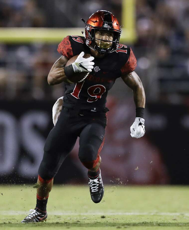 "FILE - In this Oct. 21, 2016, file photo, San Diego State running back Donnel Pumphrey runs with the ball during the second half of an NCAA college football game against San Jose State, in San Diego. A week ago before their final regular season games, both San Diego State and Wyoming knew they would be playing this weekend for the Mountain West Conference championship. And both teams looked bad in big losses. ""So we're both coming from the same situation and whichever team rebounds the best is going to win it,"" Aztecs coach Rocky Long said. (AP Photo/Gregory Bull, File) Photo: Gregory Bull, Associated Press"