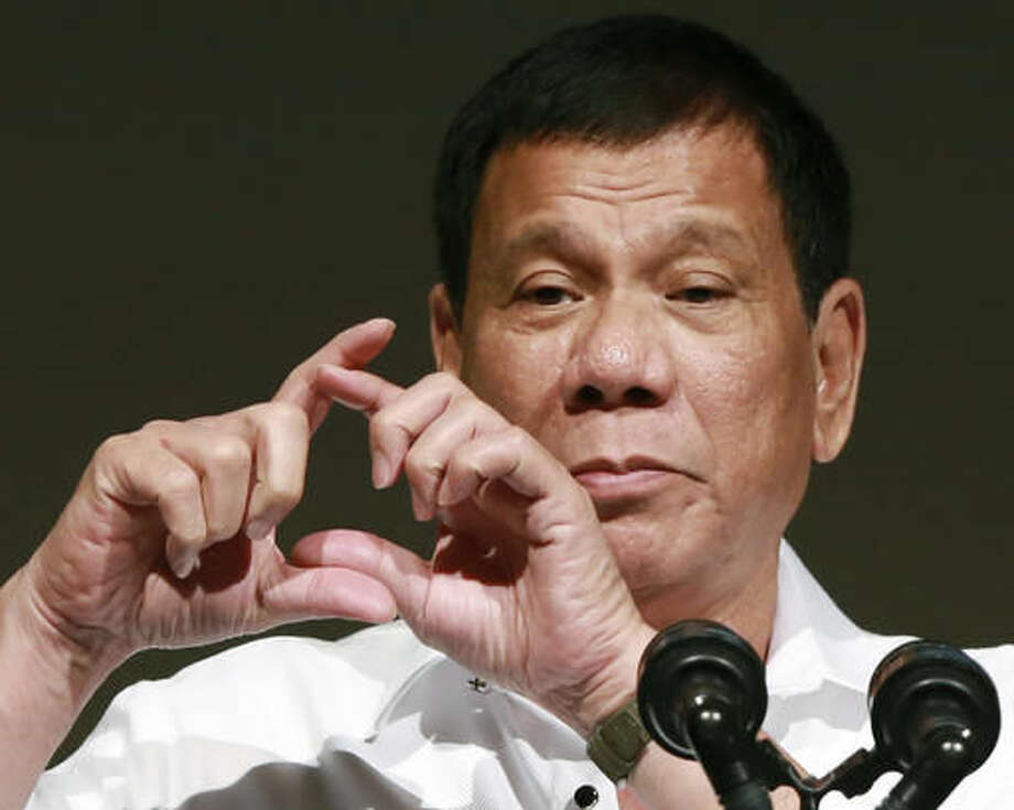 """FILE - In this Oct. 26, 2016, file photo, Philippine President Rodrigo Duterte delivers a speech at the Philippine Economic Forum in Tokyo. Duterte telephoned U.S. President-elect Donald Trump late Friday, Dec. 2 and had a brief but """"very engaging, animated conversation"""" in which both leaders invited each other to visit his country. In a video released by Duterte's close aide, Bong Go, the Philippine leader is seen smiling while talking to Trump late Friday and saying: """"We will maintain ... and enhance the bilateral ties between our two countries."""" (AP Photo/Eugene Hoshiko, File) Photo: Eugene Hoshiko"""