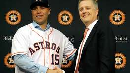 Carlos Beltran, left, said general manager Jeff Luhnow and the Astros were the most aggressive of the three or four teams he considered.