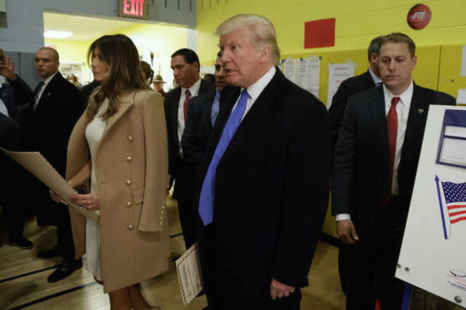 Republican presidential candidate Donald Trump walks with his wife Melania to cast their ballots at PS-59, Tuesday, Nov. 8, 2016, in New York. (AP Photo/ Evan Vucci) Photo: Evan Vucci