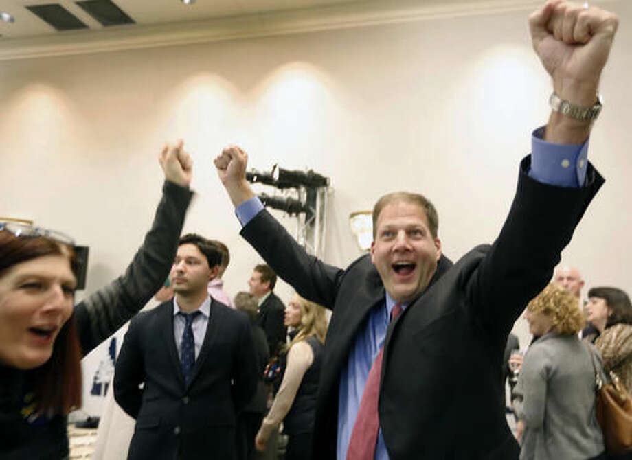 Republican Chris Sununu cheers as early results show him in the lead over Democrat Colin Van Ostern in the race for New Hampshire's governor Tuesday, Nov. 8, 2016, in Concord, N.H. (AP Photo/Jim Cole) Photo: Jim Cole