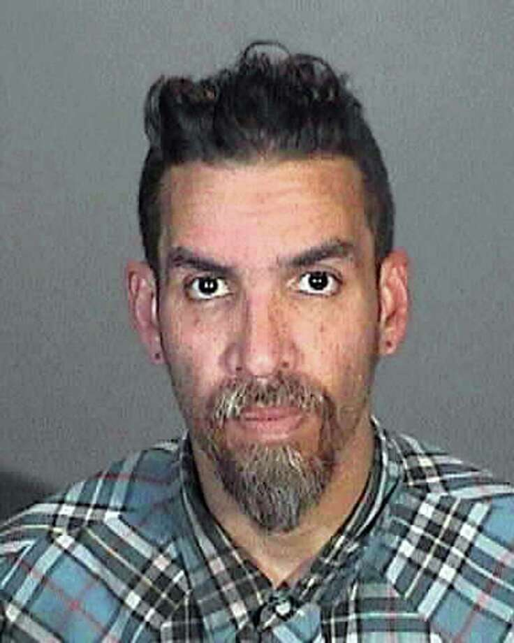 This March 12, 2015 booking photo provided by the Glendale, Calif., Police Department shows Derick Ion Almena. Almena is an operator of the Ghost Ship warehouse in Oakland, in which dozens of people died in a fire that started Dec. 2, 2016. Spokeswoman Tawnee Lightfoot says Almena was stopped for driving with expired registration and, after a consensual search, two license plates from Oakland-area stolen cars were found. The charges apparently were not pursued.  (Glendale Police Department via AP) Photo: AP / Glendale Police Department