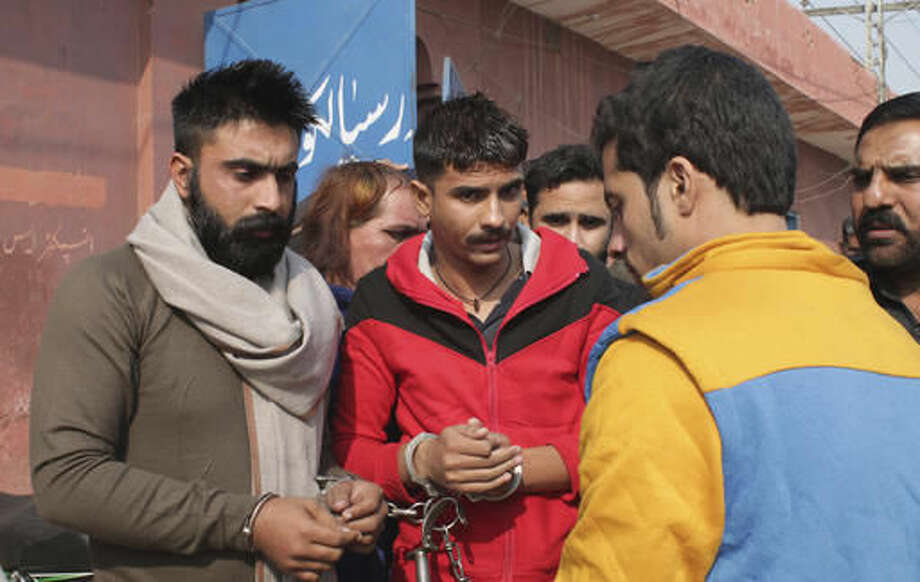 People allegedly involved in the flogging of a transgender person arrive at a court in Sialkot, Pakistan, Monday, Nov. 14, 2016. A Pakistani officer said police have arrested 10 members of a criminal gang who flogged a transgender person and posted the incident on social media. The officer said Monday's arrests were made in the eastern Pakistani city of Sialkot after a video of the flogging was shared thousands of times on social media. (AP Photo/Shahid Ikram) Photo: Shahid Ikram