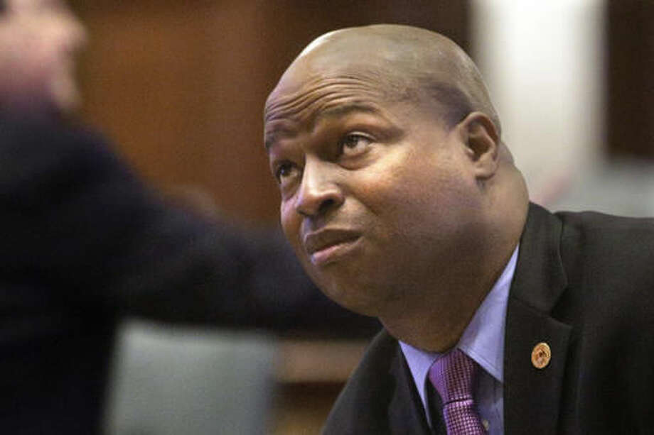 FILE-In this Feb. 16, 2016, file photo, state Rep. Emanuel Chris Welch, D-Hillside, listens to lawmakers while on the House floor during session at the Illinois State Capitol in Springfield, Ill. Half-a-dozen state representatives have sued the Illinois comptroller for holding up their paychecks during the state budget mess. (AP Photo/Seth Perlman) Photo: Seth Perlman