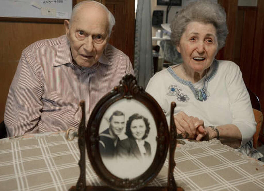 In this Oct. 21, 2016 photo, Philip and Dorothy Dougan pose as a photo sits on the table in front of them at their home in Madison County, Tenn. They are celebrating their 75th wedding anniversary. (Kenneth Cummings/The Jackson Sun via AP) Photo: Kenneth Cummings
