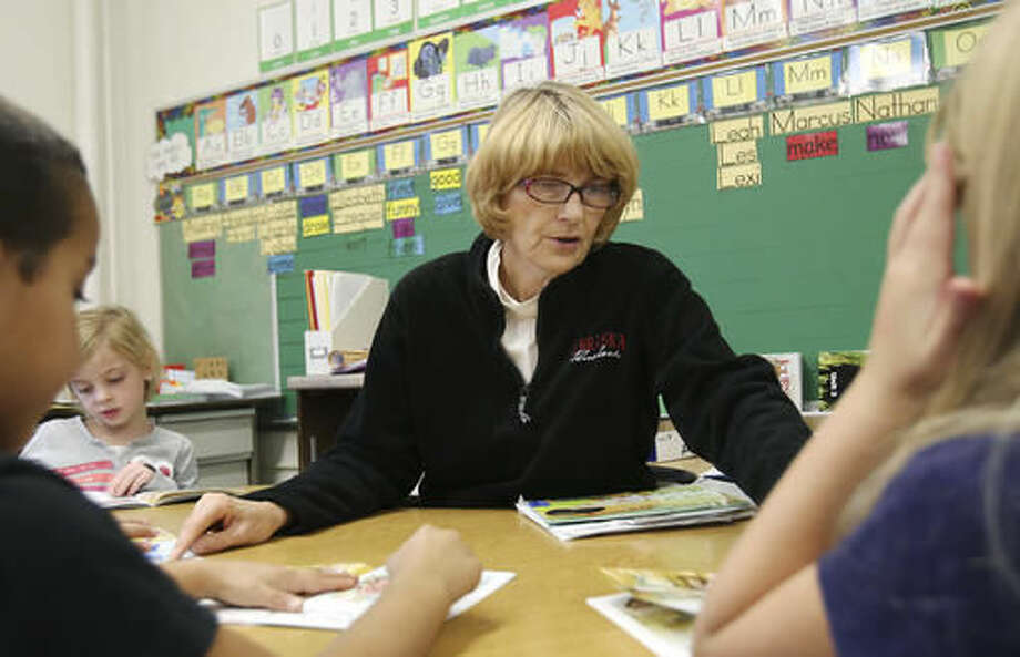 Dianne Conyers reads with first-graders at Longfellow Elementary in Hastings Neb. Nov. 17, 2016. Conyers is a long term substitute. The district currently has a list of 51 people on standby to serve as substitutes at any given point, which is down by just four from a year ago. (Laura Beahm/The Hastings Tribune via AP) Photo: Laura Beahm