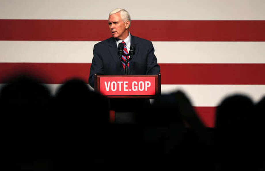 """Vice President-elect Mike Pence speaks at a """"Get Out The Vote"""" rally to stump for Republican senate candidates in New Orleans, Saturday, Dec. 3, 2016. (AP Photo/Gerald Herbert) Photo: Gerald Herbert"""