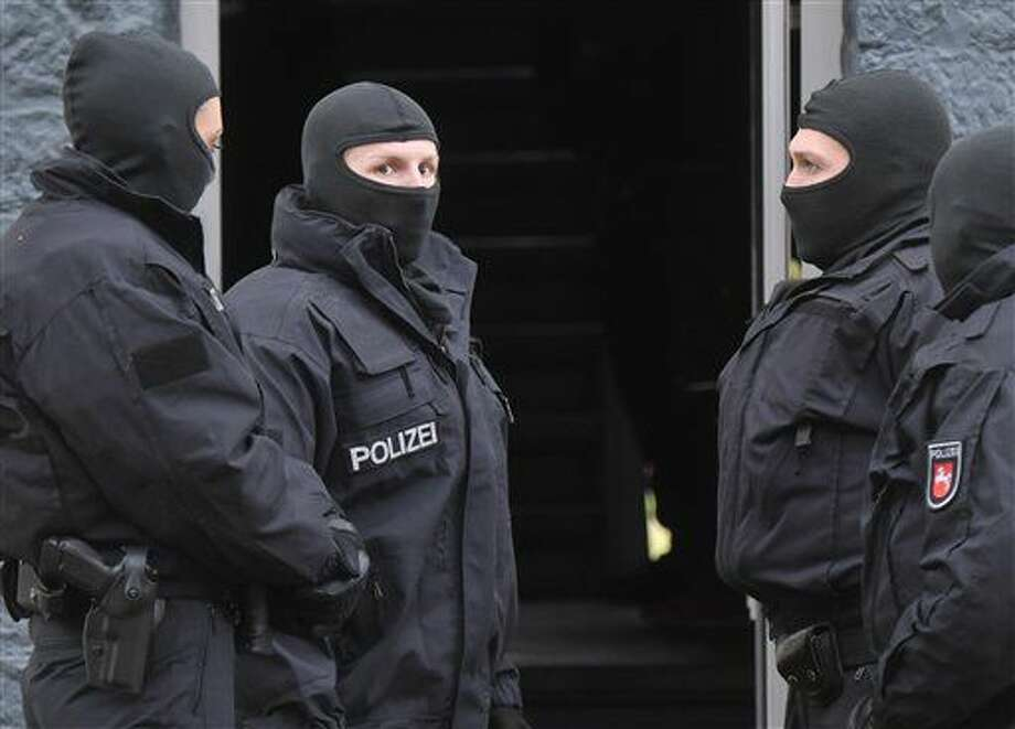 Police officers seach a residential building opposite the German-Speaking Islamic Circle Hildesheim mosque in Hildesheim, Germany, Tuesday, Nov. 8, 2016. German security authorities arrested five men Tuesday on allegations they aided the Islamic State group in Germany, recruiting members and providing financial and logistical help. (Julian Stratenschulte/dpa via AP) Photo: Julian Stratenschulte