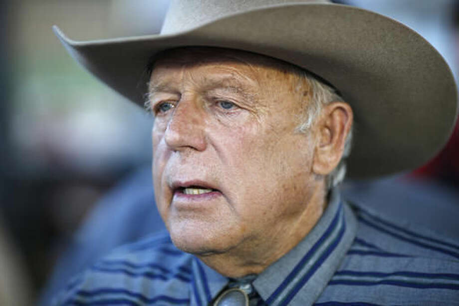 FILE - In this April 11, 2015, file photo, Nevada rancher Cliven Bundy speaks with supporters at an event in Bunkerville, Nev. Prosecutors want a federal judge in Nevada to schedule three group trials for the 17 defendants facing charges in an armed confrontation with U.S. officials over grazing rights near cattleman Bundy's ranch. (AP Photo/John Locher, File) Photo: John Locher