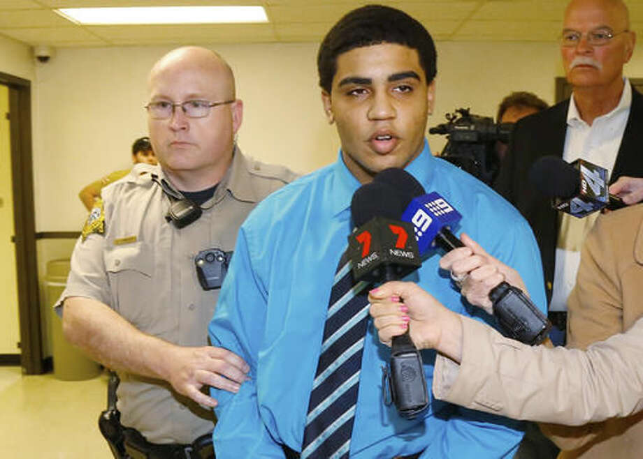 FILE - In this April 17, 2015 file photo, Chancey Luna answers a question for the media as he is led from the courthouse to the jail after being convicted in the death of Christopher Lane in Duncan, Okla. An Oklahoma appeals court on Friday, Dec. 2, 2016, ordered a new sentencing for Luna who has been serving a life in prison without parole term for the fatal shooting of Lane, an Australian baseball player three years ago. (AP Photo/Sue Ogrocki File) Photo: Sue Ogrocki