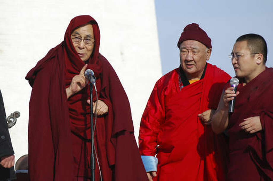 The Dalai Lama, left, speaks at the Janraiseg Temple of Gandantegchinlen monastery in Ulaanbaatar, Mongolia, Saturday, Nov. 19, 2016. The Dalai Lama has preached to thousands of supporters Saturday in Mongolia on a visit set to test the country's ties with its powerful neighbor, China. (AP Photo/ Ganbat Namjilsangarav) Photo: Ganbat Namjilsangarav