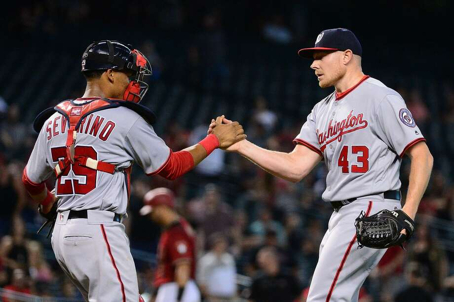 Catcher Pedro Severino congratulates closer Mark Melancon, acquired by the Nationals for last season's stretch run. Photo: Jennifer Stewart / Getty Images / 2016 Getty Images
