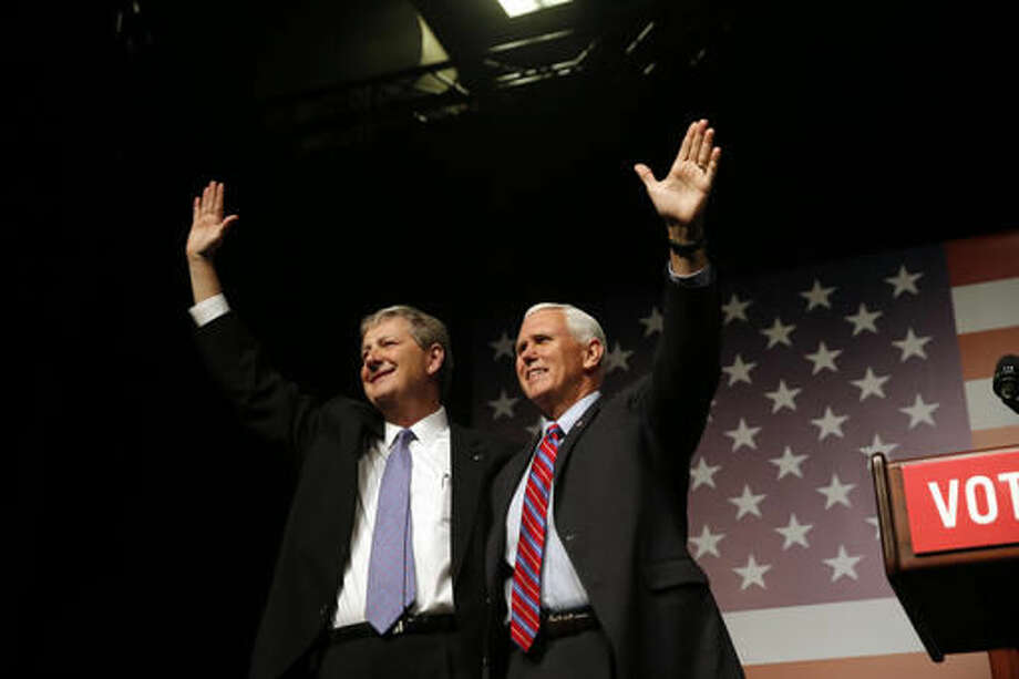 """Vice President-elect Mike Pence arrives at a """"Get Out The Vote"""" rally to stump for Republican senate candidate, Louisiana Treasurer John Kennedy, left, in New Orleans, Saturday, Dec. 3, 2016. (AP Photo/Gerald Herbert) Photo: Gerald Herbert"""