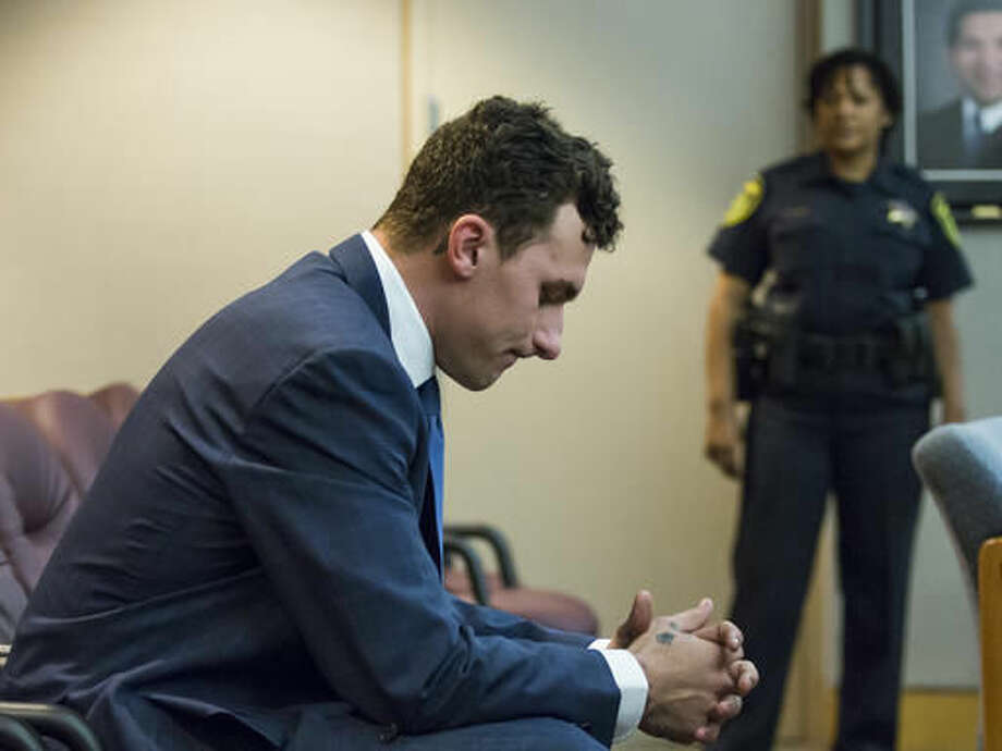 FILE - In this May 5, 2016, file photo, former Cleveland Browns quarterback Johnny Manziel sits at the back of the courtroom while his defense attorneys confer with the prosecution during his initial hearing in Dallas. Prosecutors say they have an agreement with Johnny Manziel to dismiss a domestic violence charge against the Heisman Trophy-winning quarterback. The Dallas County District Attorney's Office said Friday, Dec. 2, 2016, that Manziel will have to meet certain conditions for a year before the misdemeanor charge will be dismissed. The former Browns player was accused of hitting and threatening former girlfriend Colleen Crowley during a night out in January. (Smiley N. Pool/The Dallas Morning News via AP, Pool File) Photo: Smiley N. Pool