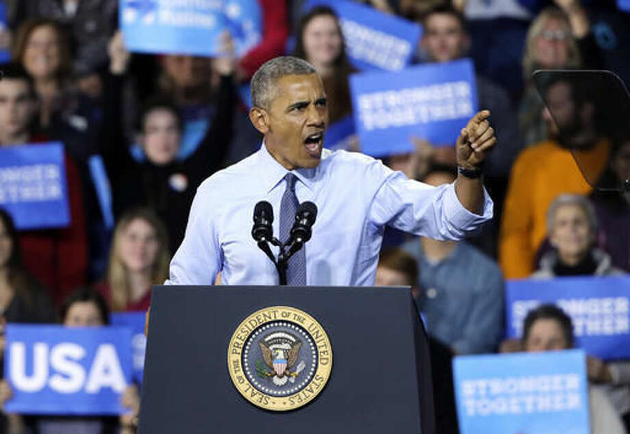 President Barack Obama speaks at a campaign event for Democratic presidential candidate Hillary Clinton at the University of New Hampshire, Monday, Nov. 7, 2016, in Durham, N.H. (AP Photo/Elise Amendola) Photo: Elise Amendola