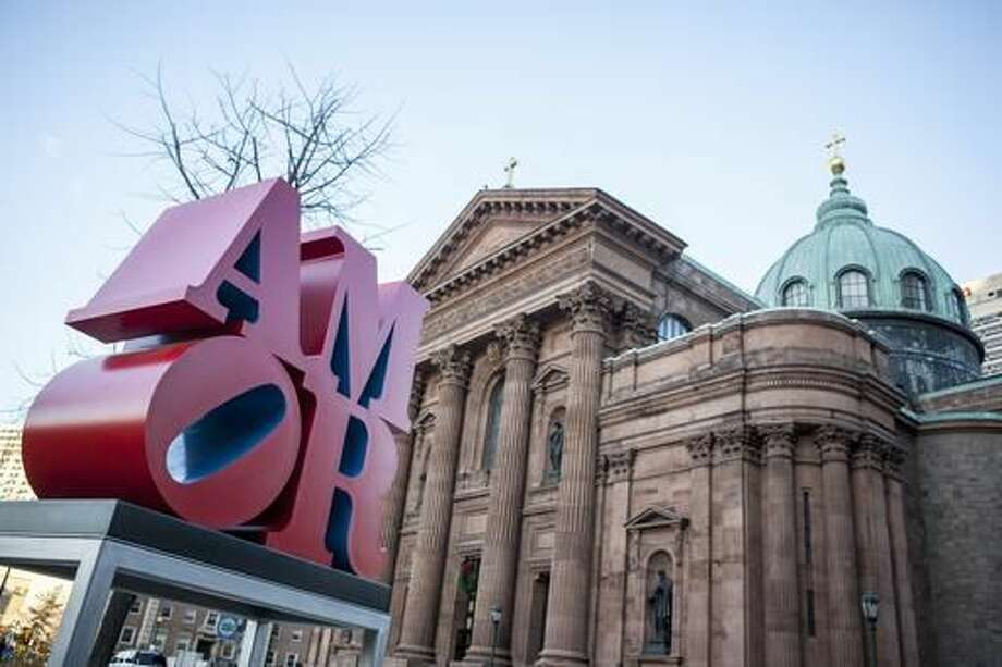 This photo shows Robert Indiana's AMOR sculpture in a park outside Philadelphia's Cathedral Basilica of Saints Peter and Paul, Friday, Dec. 2, 2016. Officials say the sculpture, originally loaned to Philadelphia for last year's papal visit, will permanently remain in the city. It's a Spanish and Latin version of Indiana's LOVE sculpture, which is a Philadelphia landmark. (AP Photo/Michael R. Sisak) Photo: Michael R. Sisak