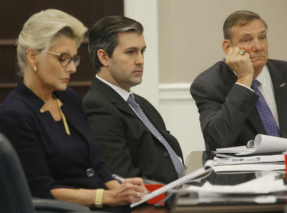 Former North Charleston police officer Michael Slager, center, sits in the courtroom during his murder trial at the Charleston County court in Charleston, S.C., Wednesday, Nov. 30, 2016. Closing arguments are underway in a South Carolina courtroom in the trial of a white former police officer charged with murder in the shooting death of an unarmed black motorist. (Grace Beahm/Post and Courier via AP, Pool) Photo: Grace Beahm