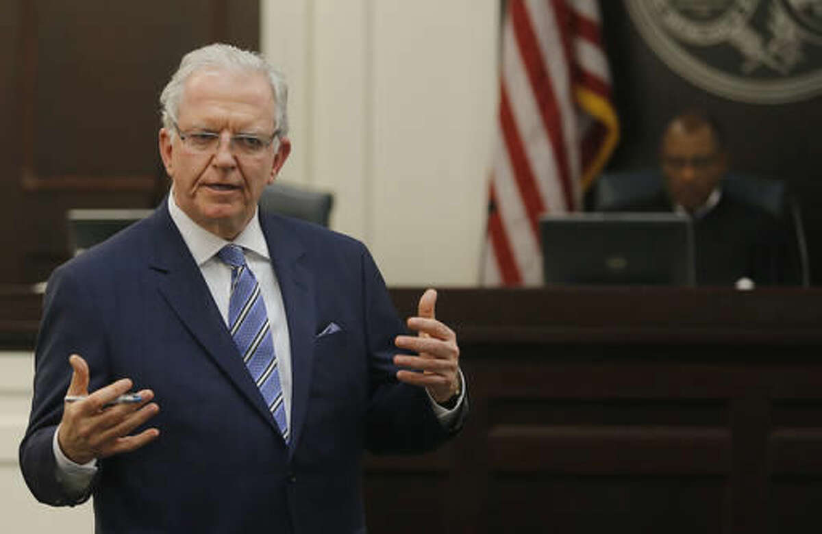 Defense attorney Andy Savage speaks to the jury during the murder trial of North Charleston police officer Michael Slager at the Charleston County court in Charleston, S.C., Wednesday, Nov. 30, 2016. Closing arguments are underway in a South Carolina courtroom in the trial of a white former police officer charged with murder in the shooting death of an unarmed black motorist. (Grace Beahm/Post and Courier via AP, Pool)