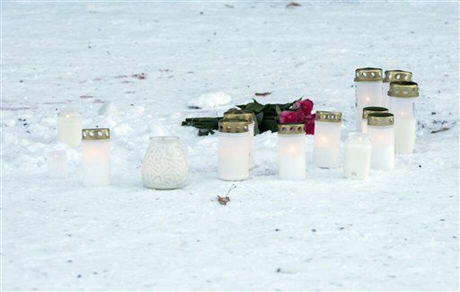 Candles in front of the restaurant Vuoksenvahti where three women were killed in a shooting incident, in Imatra, Finland, Sunday, Dec. 4, 2016. A gunman killed a local town councilor and two journalists, all women, in an apparent random shooting in a nightlife district in a small town in southeastern Finland, police said Sunday. A male suspect has been detained. (Hannu Rissanen/Lehtikuva via AP) Photo: Hannu Rissanen