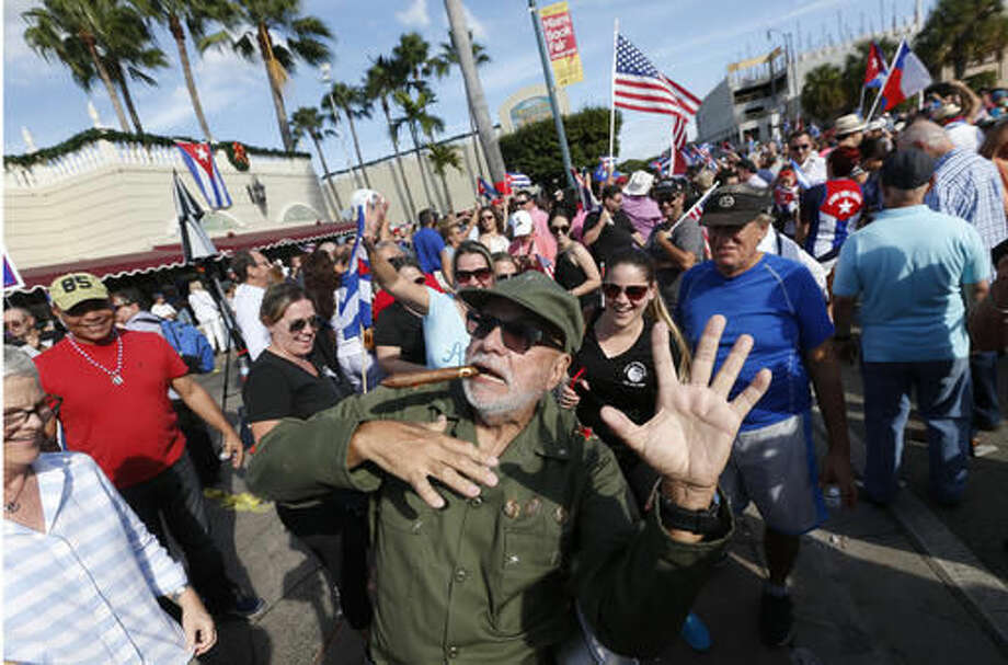 FILE - This Nov. 26, 2016 file photo shows Jose Fernandez dressed as Fidel Castro feigning death as he and other members of the Cuban community celebrate Fidel Castro's death outside Versailles Restaurant in the Little Havana neighborhood of Miami. Some Cuban-Americans have been celebrating Castro's death with jubilation and vulgar humor, calling it a well-earned release after decades of exile and insults from the man they blame for ruining their country. (AP Photo/Wilfredo Lee, File) Photo: Wilfredo Lee