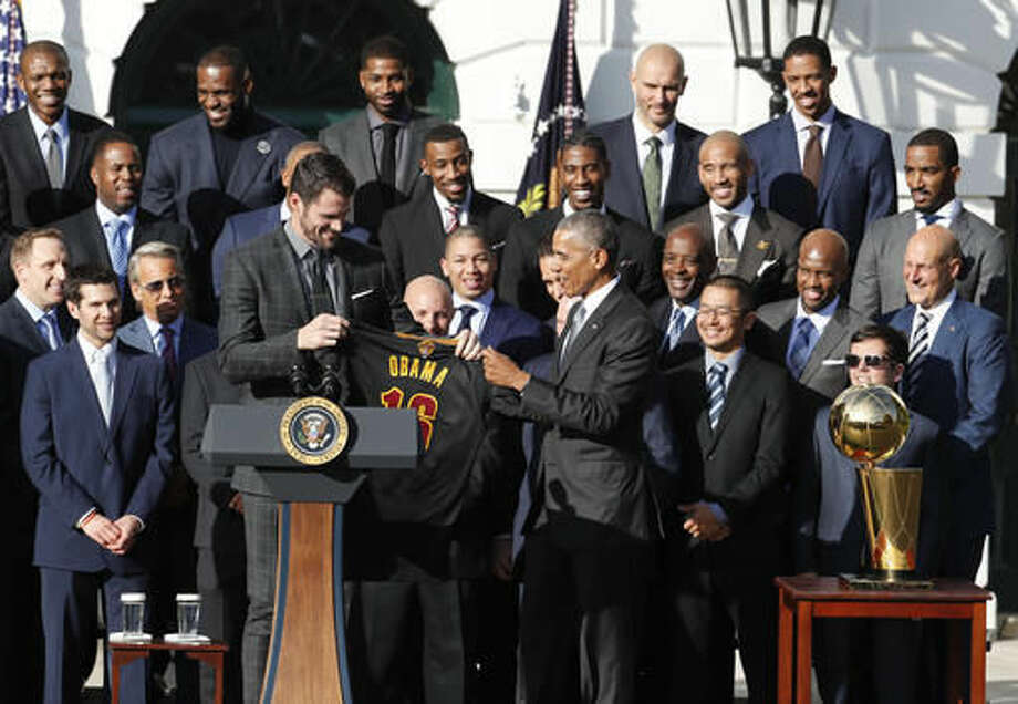 President Barack Obama accepts a team basketball jersey from Cleveland Cavaliers team members Kevin Love, left, as the president honored the 2016 NBA Champions Cleveland Cavaliers basketball team during a ceremony on the South Lawn of the White House in Washington, Thursday, Nov. 10, 2016. (AP Photo/Pablo Martinez Monsivais) Photo: Pablo Martinez Monsivais