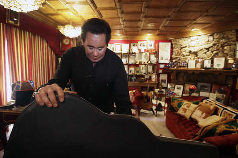 FILE - In this Friday, Nov. 12, 2010, file photo, Wayne Newton shows some of the memorabilia in the Red Room during an interview at his home in Las Vegas. Feathers are flying in the neighborhood around Newton's estate, where residents are complaining that peafowl like the ones on the Las Vegas showman's 40-acre ranch have become roosting and roaming pests. (AP Photo/Julie Jacobson, File) Photo: Julie Jacobson