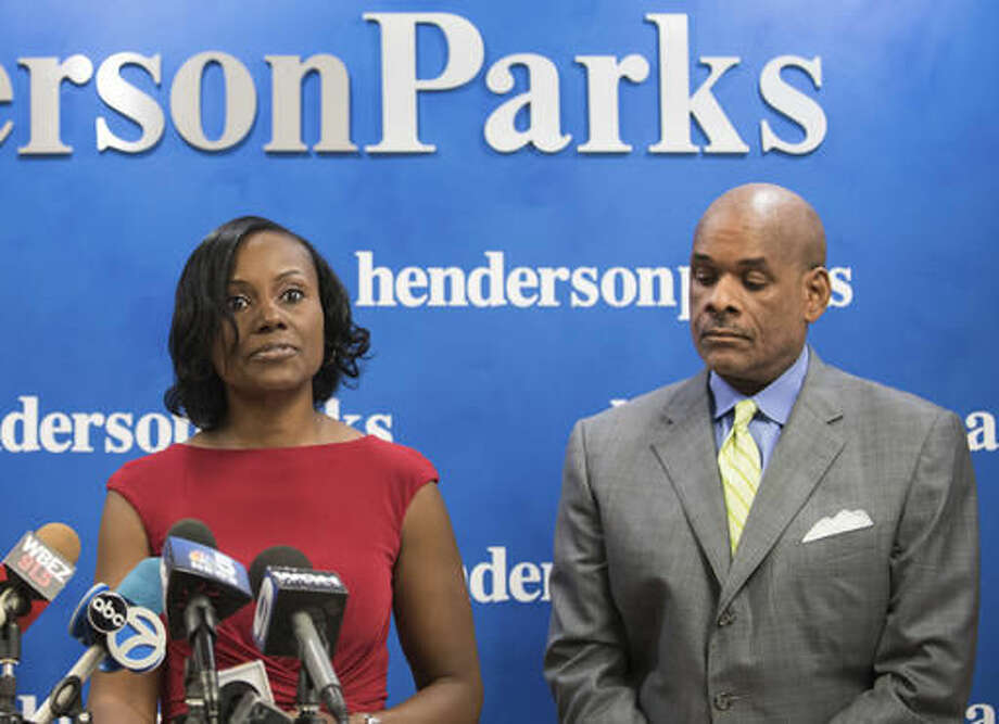 FILE - In this Sept. 22, 2016, file photo, attorney Rhonda Crawford stands alongside her attorney Victor Henderson in Chicago, as she addresses allegations that she impersonated a judge. Crawford, a former law clerk who was fired for impersonating a judge, now is running to become one, and critics say her expected victory is a product of Illinois' system for filling judicial vacancies. (Max Herman/Chicago Sun-Times via AP, File)