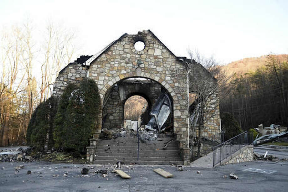 The stone walls are all that stands of the Roaring Fork Baptist Church in Gatlinburg, Tenn., Friday, Dec. 2, 2016, following the devastating wildfires from Monday night, Nov. 28. (Amy Smotherman Burgess/Knoxville News Sentinel via AP) Photo: AMY SMOTHERMAN BURGESS