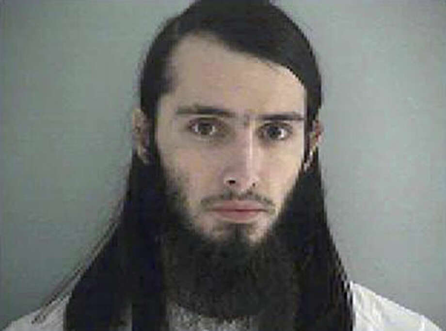 FILE - This Jan. 14, 2015, file photo made available by the Butler County Jail in Hamilton, Ohio, shows Christopher Lee Cornell of Green Township in suburban Cincinnati. The sentencing of Christopher Lee Cornell, accused of plotting to attack the U.S. Capitol in support of the Islamic State group, has been rescheduled to Monday, Dec. 5, 2016, after he pleaded guilty Aug. 1, 2016, to three federal charges stemming from his Jan. 14, 2015, arrest. A car-and-knife attack at Ohio State University on Monday, Nov. 28, 2016, is the latest in a series of cases involving young men who apparently became radicalized in the heartland state. (Butler County Jail via AP, File) Photo: Uncredited