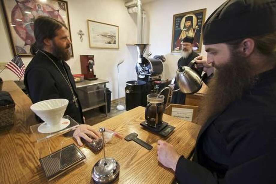 Father Innocent Neal and monks Stephen Lindell and Daniel Armstrong, clergy at St. Tikhon's Monastery, roast beans and make coffee inside the bookstore in Waymart, Pa., on Nov. 1, 2016. The clergy at St. Tikhon's Bookstore, the nation's largest Orthodox bookstore and printing press, started Burning Bush Coffee Roasters in January. Since then, the monks embraced coffee roasting and became experts. (Michael J. Mullen/The Times & Tribune via AP) Photo: Michael J. Mullen