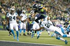 SEATTLE, WA - DECEMBER 04:  Running back Thomas Rawls #34 of the Seattle Seahawks scores a touchdown against the Carolina Panthers at CenturyLink Field on December 4, 2016 in Seattle, Washington.  (Photo by Jonathan Ferrey/Getty Images)