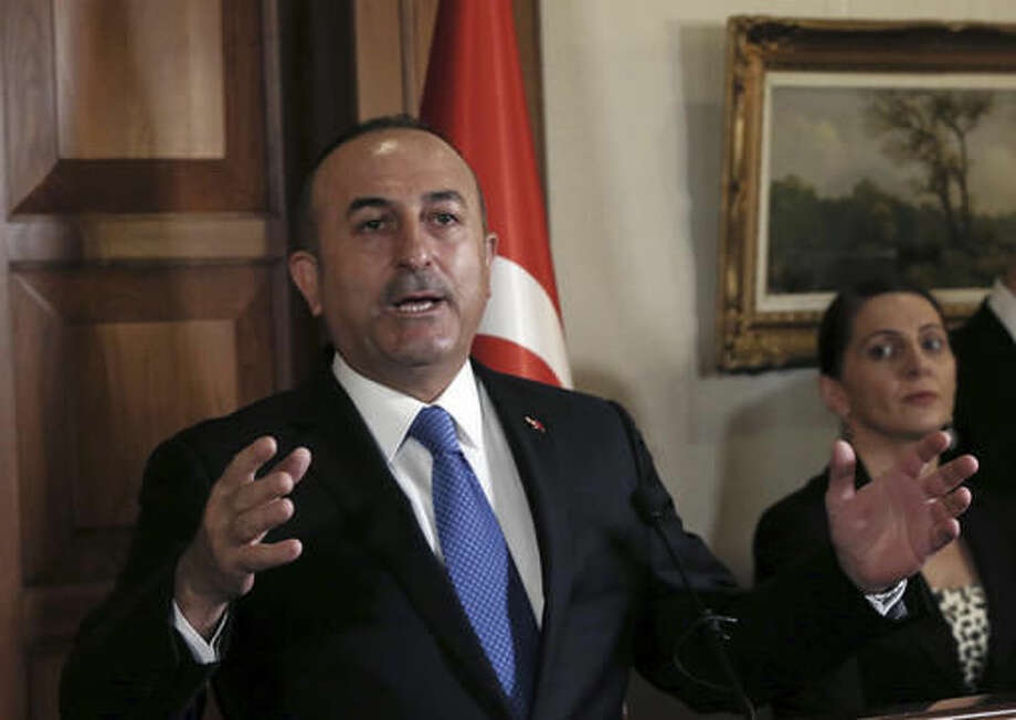 Turkey's Foreign Minister Mevlut Cavusoglu speaks to the media during a joint news conference with his Bosnian counterpart Igor Crnadak in Ankara, Turkey, Tuesday, Nov. 8, 2016. The United States has promised Turkey that U.S.-backed Syrian Kurdish forces will only be involved in a siege of the Islamic State stronghold of Raqqa, but would not enter the city itself, Cavusoglu said Tuesday. (AP Photo/Burhan Ozbilici) Photo: Burhan Ozbilici